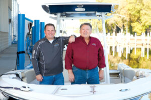 Stand by me Rob Kotowski, owner and president of Lake Shore Boat Top Co., with his father and mentor Bob Kotowski.
